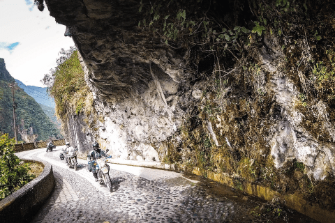 Riding under the cliffs near Rio Verde Ecuador