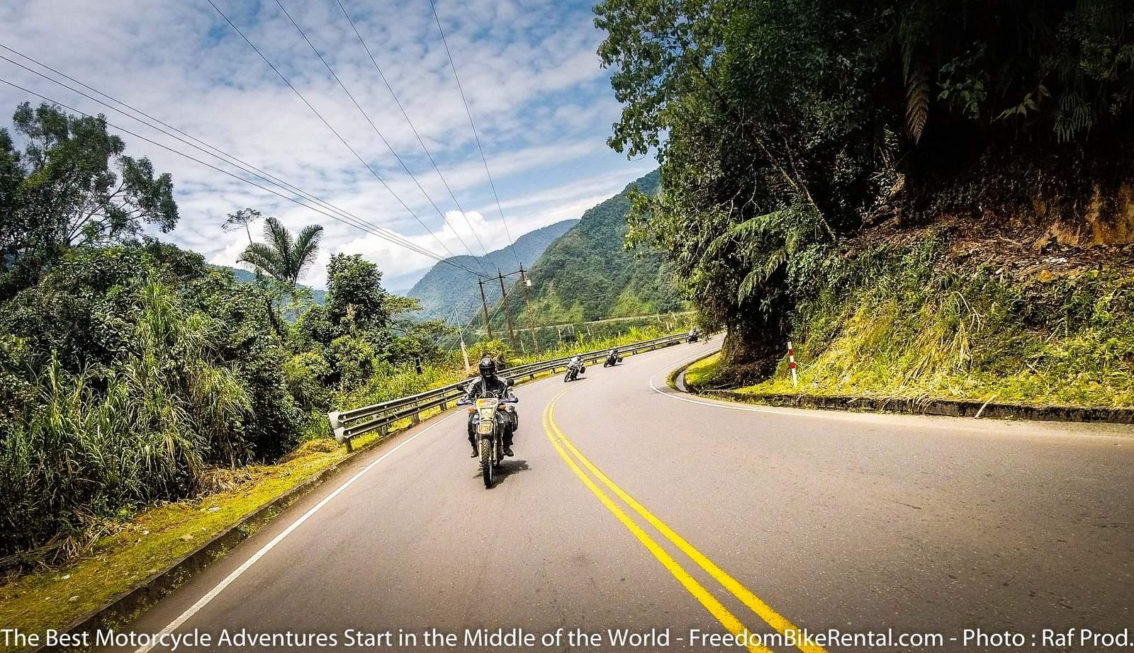 Group Motorcycle tour on paved road in Ecuador