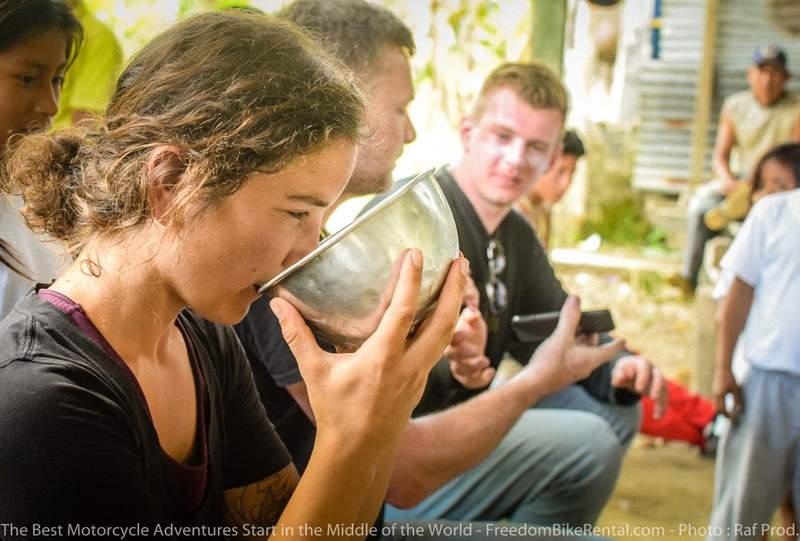 drinking chicha in the ecuador amazon during motorcycle adventure tour