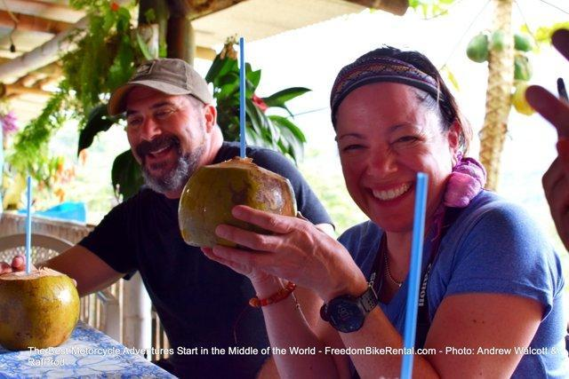 drinking from a fresh coconut on motorcycle tour in ecuador