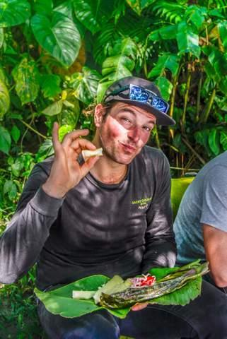 enjoying fish meal in the ecuador amazon jungle on motorcycle adventure tour