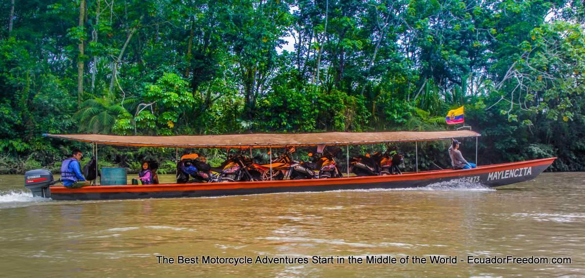 motorcycle traveliung on motorized canoe in ecuador amazon napo river