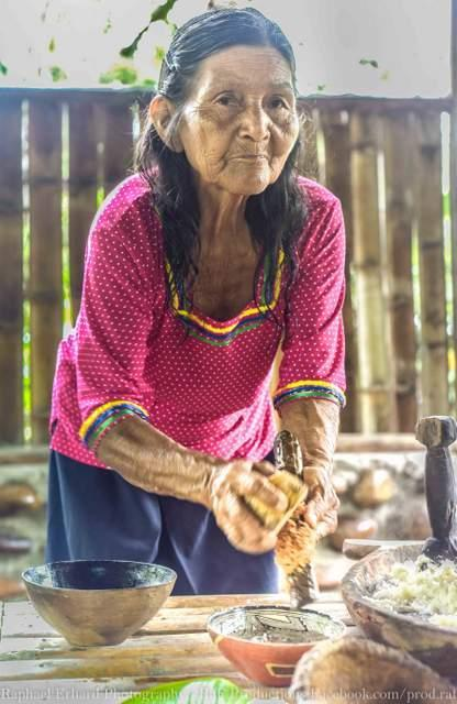 woman preparing food in ecuador amazon basin on motorcycle tour