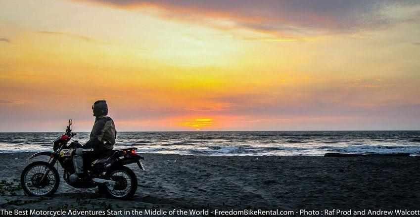 Motorcycle Suzuki DR650 on Canoa Beach at sunset