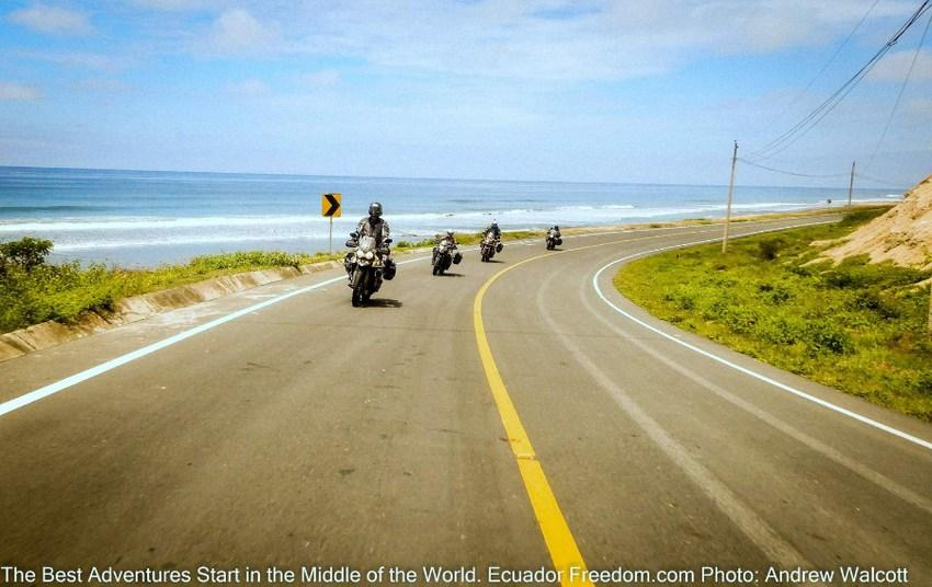 four motorcycles riding along the pacific coast in ecuador