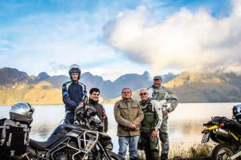 guided motorcycle tour group at high elevation mojanda lake in ecuador