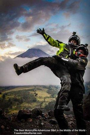 happy motorcyclists at tungurahua volcano in ecuador