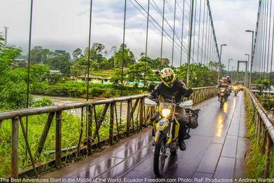 motorcycles crossing metal bridge in puerto misahualli ecuador in the amazon basin
