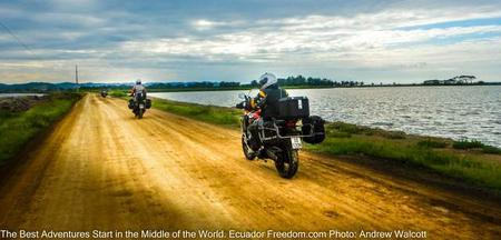 motorcycles on a causeway between shrimp farms on the coast of ecuador
