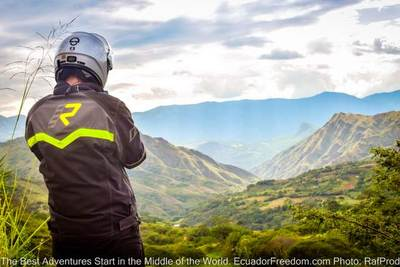 motorcyclist overlooking mountains in southern ecuador