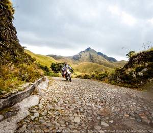 riding a dual sport motorcycle to laguna mojanda near otavalo ecuador