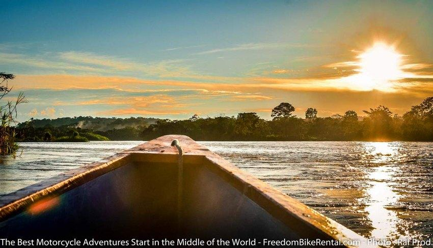 riding in a motorized canoe on the napo river in the ecuador amazon jungle