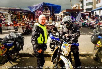 the market at saquisili with adventure motorcyclists taking a stop