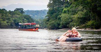 tubing floating on an innertube in the napo river ecuador