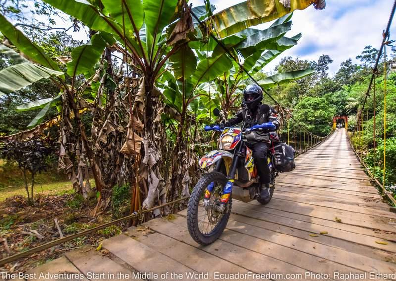 wire suspension bridge in ecuador KTM 690 on dual sport motorcyle adventure tour