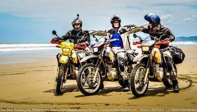 3 amigos on suzuki dr650 on beach in ecuador motorcycle adventure tour