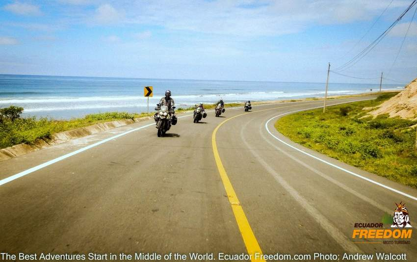 group of 4 motorcycles on a paved road on along the pacific coast of Ecuador