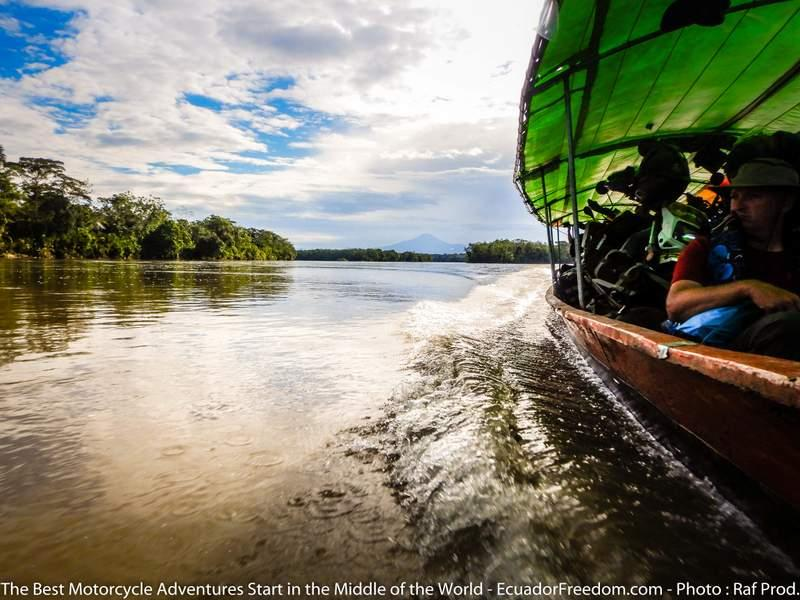 motorcycles in a canoe in the Amazon jungle