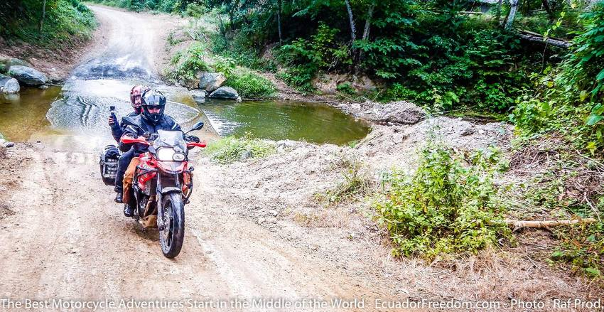 small brook crossing on coastal dirt road in ecuador on bmw f800GS motorcycle adventure tour