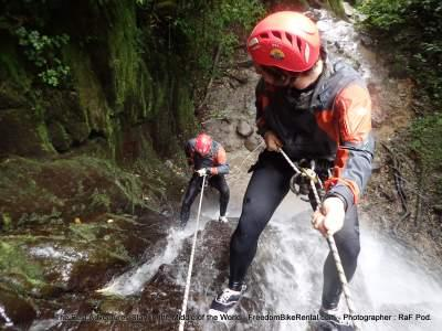 canopying rapelling down a waterfall in banos on a motorcycle tour in ecuador