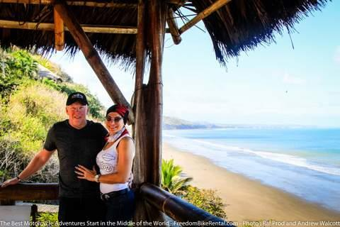 couple on motorcycle tour at beach in ecuador south america