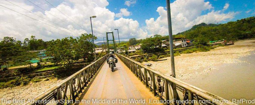 crossing the bridge in misahualli napo ecuador motorcycle adventure tour