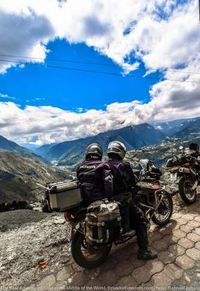 Motorcycle with view of banos ecuador below