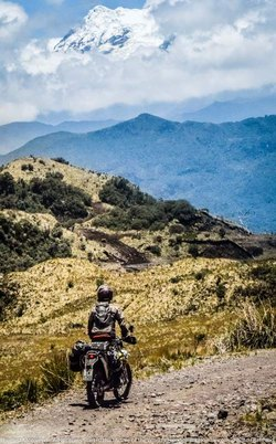 dirt deluxe dirt bike motorcycle tour ecuador looking at cayambe