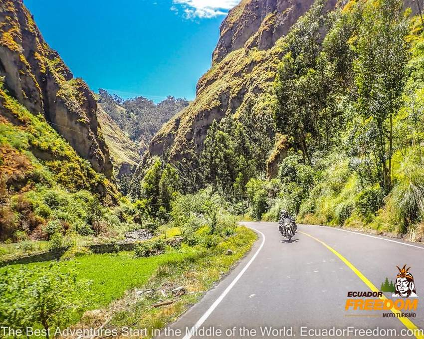 happy motorcyclists riding a self guided motorcycle tour in Ecuador in a canyon road with curves