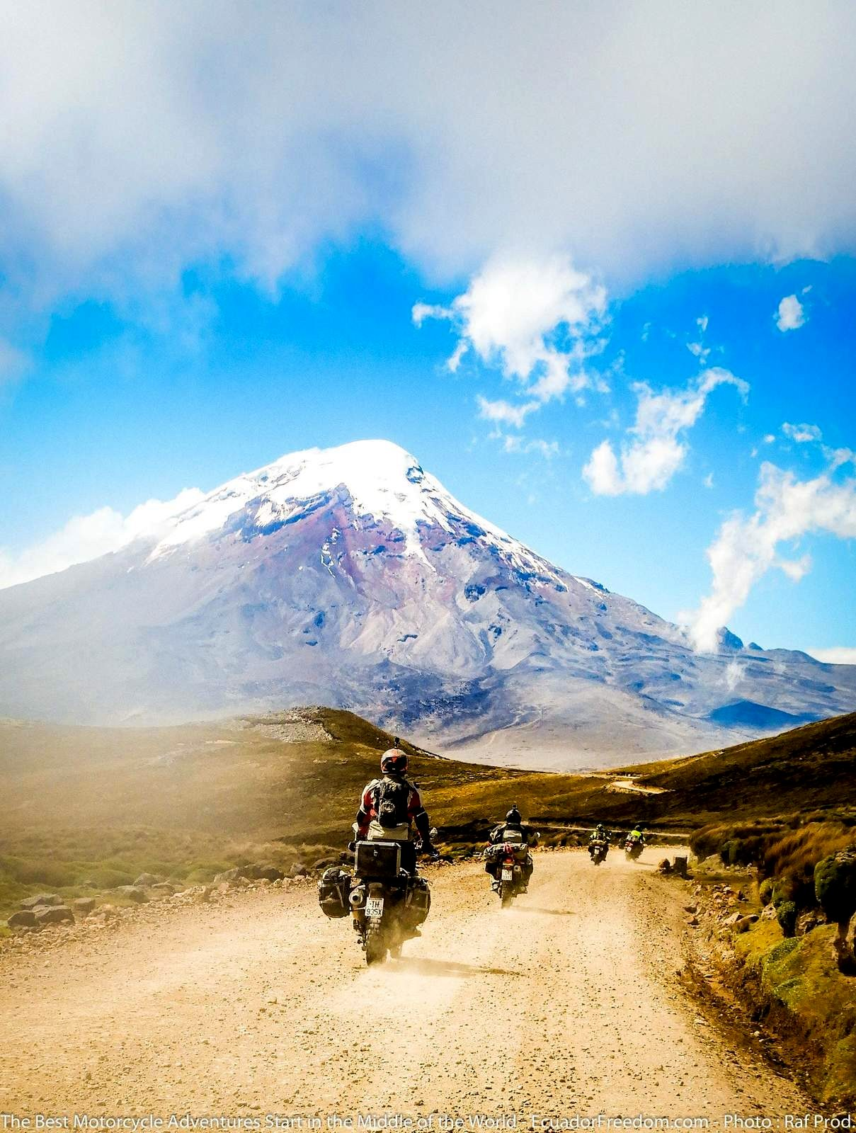 riding dual sport motorcycles towards Chimborazo on a dirt road in Ecuador