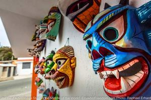 tribal masks in tigua ecuador on motorcycle adventure tour