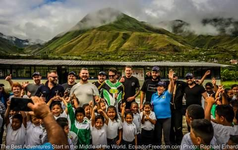 motorcycle tour group at a school visit pack for a purpose ecuador