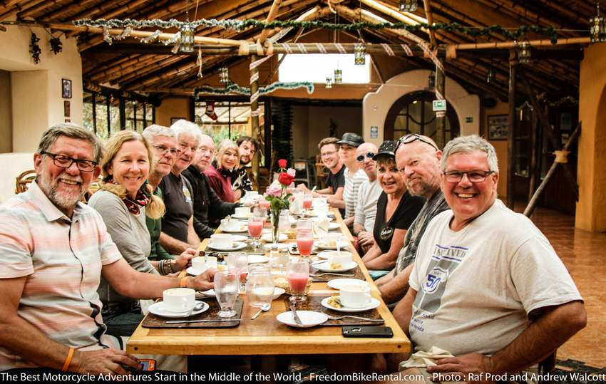 motorcycle tour group eating in a restaurant together in Ecuador