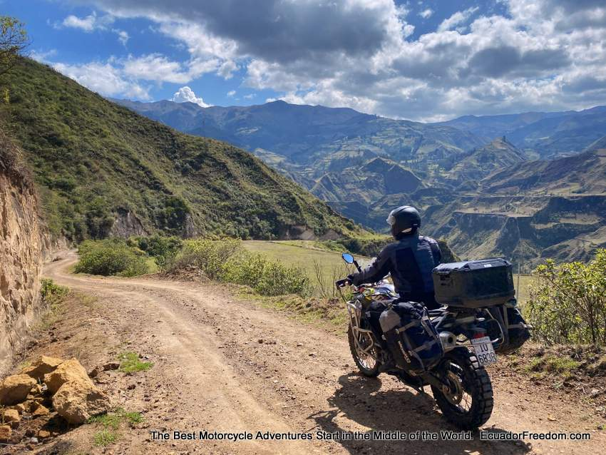 motorcycle touring on a dirt road in Ecuador