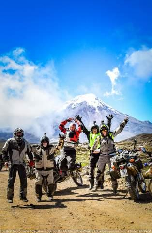 motorcyclists jumping for joy on a motorcycle tour in ecuador