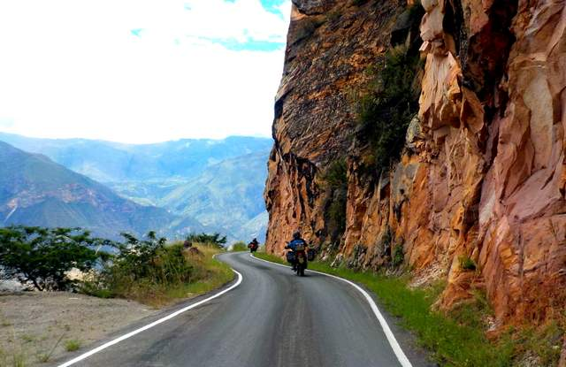 adventure motorcycle tour in peru riding on a mountain road