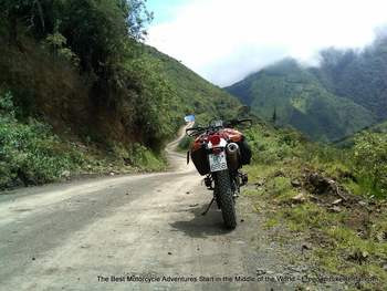 motorcycle on dirt road to mindo ecuador