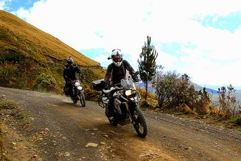 Riding a BMW F800GS on dirt road in Ecuador