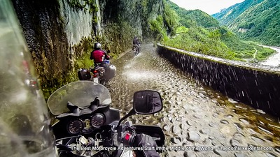 riding  motorcycles on cobbled road towards amazon basin in ecuador