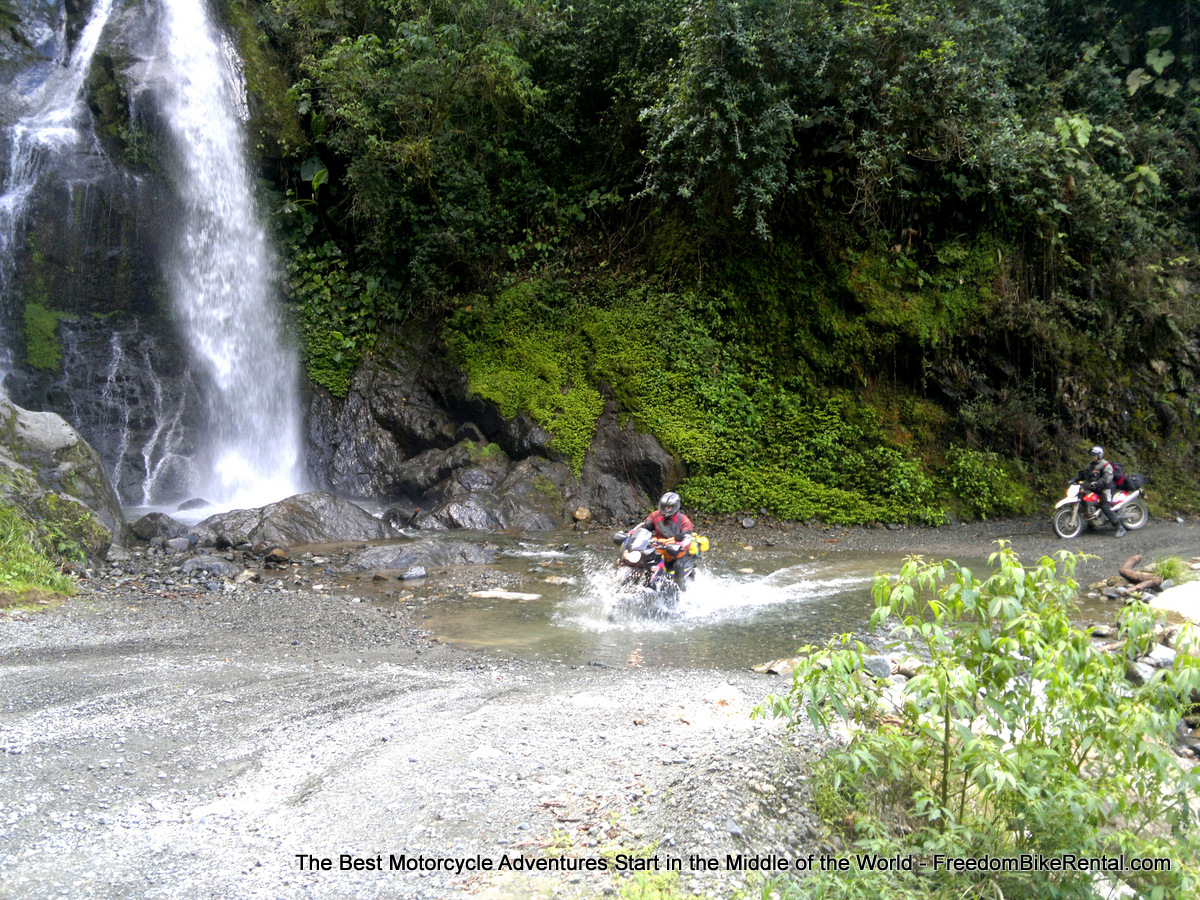 small_moto_river_crossing_selva_alegre_ecuador