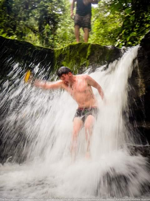taking a break from the motorcycle tour swimming in a waterfall in ecuador