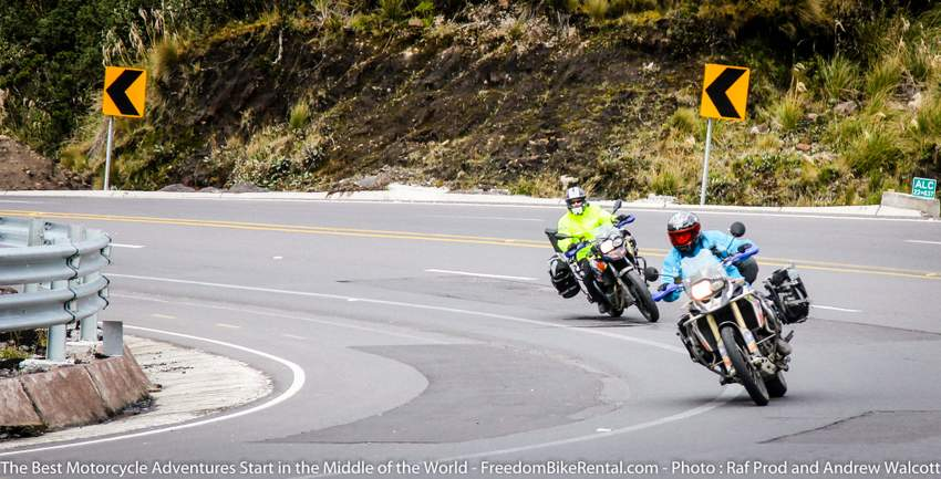 two adventure riders on a curvy mountain road on a motorcycle tour in Ecuador