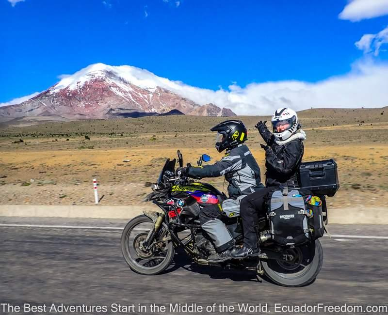 two up motorcyclists on the road around chimborazo on an adventure motorcycle